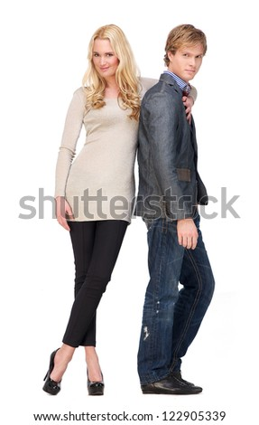 Full body portrait of boyfriend and girlfriend standing in a fashion pose. Isolated on white background - stock photo