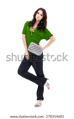 Full body portrait of girl holding purse s posing in studio - stock photo