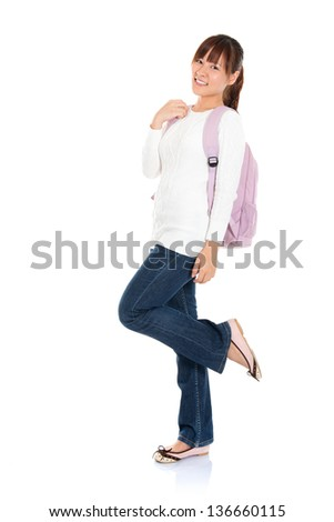 Full body portrait of happy Asian woman young adult student standing isolated on white background - stock photo