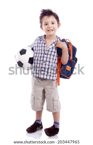 Full body portrait of happy school kid holding a soccer ball, isolated on white background - stock photo