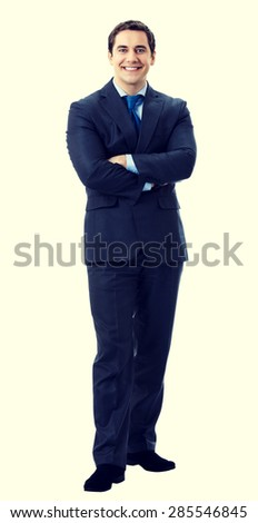 Full body portrait of happy smiling cheerful businessman in crossed arms pose - stock photo