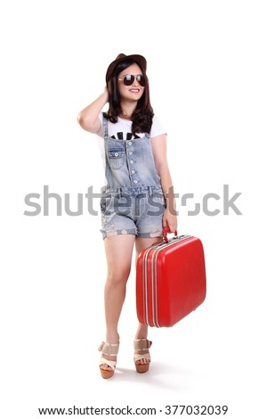 Full body portrait of happy young woman in vintage fashion going on vacation, isolated on white background - stock photo