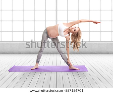 Full Body Portrait Of Pregnant Woman Doing Yoga On a Purple Exercise Mat in front of a large window.