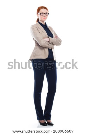 Full body portrait of red hair business woman with crossed arms, isolated on white