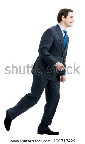 Full body portrait of running young business man, isolated over white background