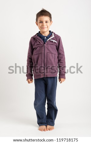 Full body portrait of six year kid against white background.