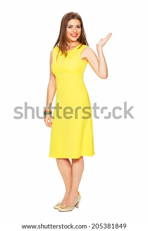 Full body portrait of smiling woman in yellow dress finger pointing. - stock photo