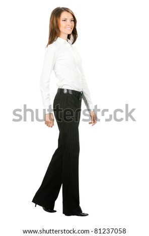 Full body portrait of walking business woman, isolated on white background - stock photo