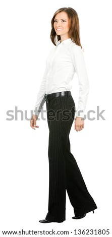 Full body portrait of walking business woman, isolated over white background - stock photo