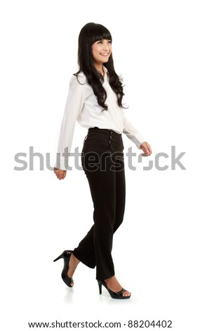 Full body portrait of walking businesswoman, full isolated on white - stock photo