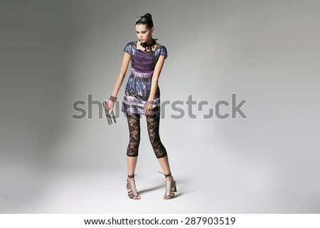 Full body portrait of young beautiful girl holding purse. Fashion photo - stock photo