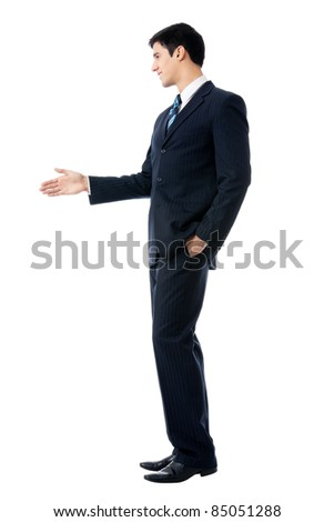 Full body portrait of young business man giving hand for handshake, isolated on white background
