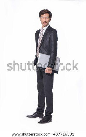 Full body Portrait of young business men holding laptop