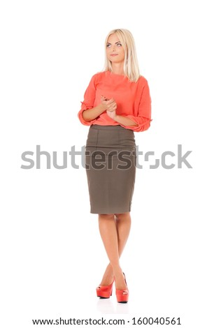 Full body portrait of young business woman, isolated on white background  - stock photo