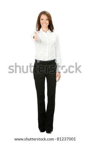 Full body portrait of young cheerful beautiful business woman giving hand for handshake, isolated on white background