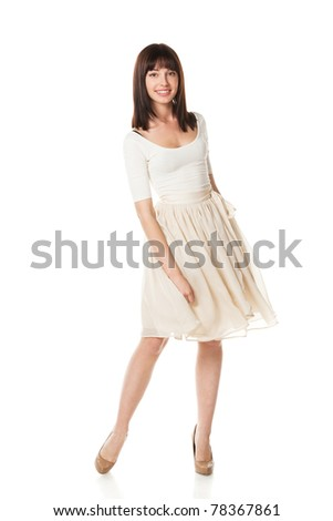 Full-body portrait of young elegant female in pastel dress isolated on white background