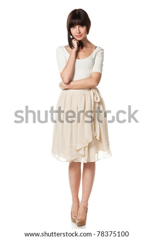 Full-body portrait of young elegant female in pastel dress isolated on white background - stock photo