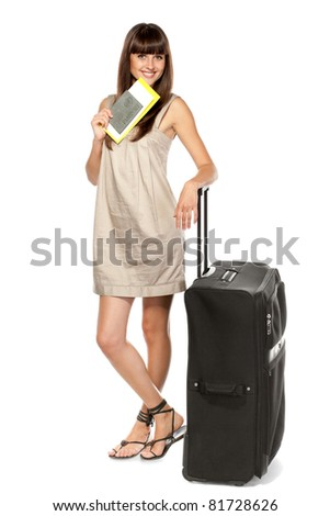 Full-body portrait of young female in dress with passport, tickets and suitcase going on holidays isolated on white background
