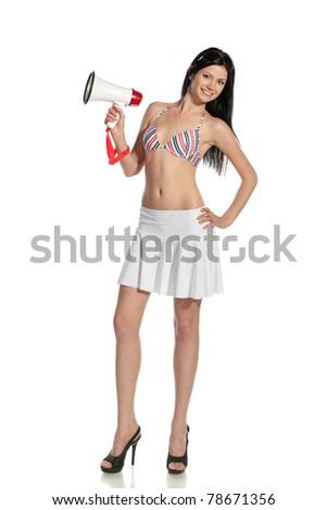 Full-body portrait of young happy female holding megaphone isolated on white background - stock photo
