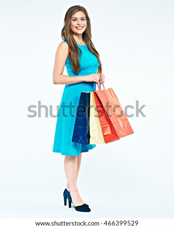 Full body portrait of young woman with shopping bag. Smiling female model isolated  on white background.