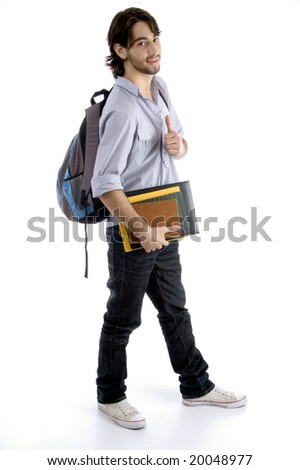 full body pose of student holding his books with white background - stock photo