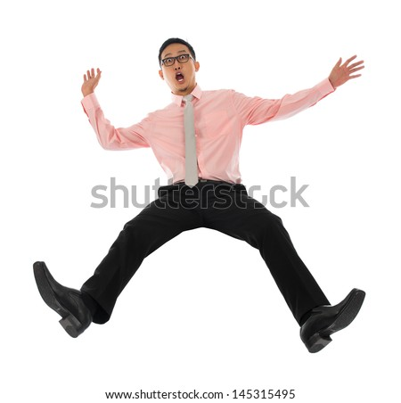 Full body shocked young Asian businessman falling backwards open arms, isolated on white background - stock photo