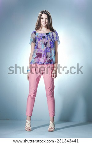 Full body shot of a beautiful vogue style girl posing - stock photo