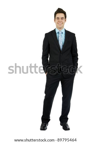Full body shot of a smiling dashing handsome young man in his business suit with hands in pocket, isolated on white background. - stock photo