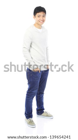 Full body shot of a smiling teenager wearing casual sweater and jeans