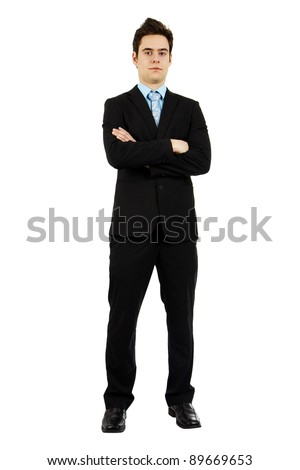 Full body shot of an handsome confident serious young man in business suit with arms crossed. - stock photo