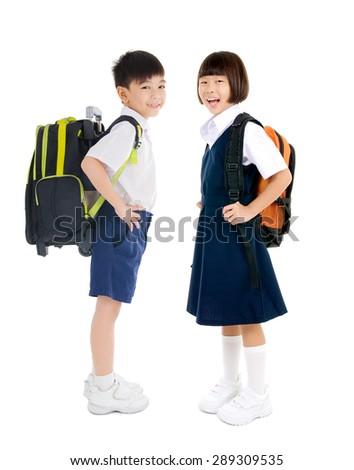 Full body shot of asian primary school students - stock photo