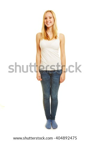 Full body shot of young blonde happy woman isolated on white background