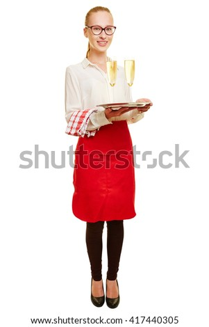 Full body shot of young woman as waiter with sparkling wine on a tray - stock photo