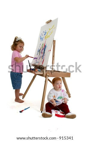 Full body shots of two young children painting.