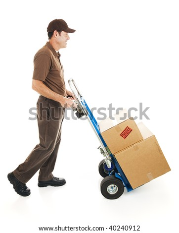 Full body side view of a delivery man or mover carrying boxes on a hand truck.  Isolated - stock photo