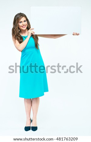 Full body smiling  woman portrait. Girl holding white blank board. Isolated white background. Casual dress.