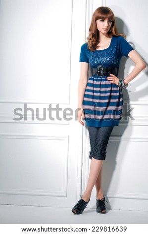 Full body standing young woman in posing  - stock photo