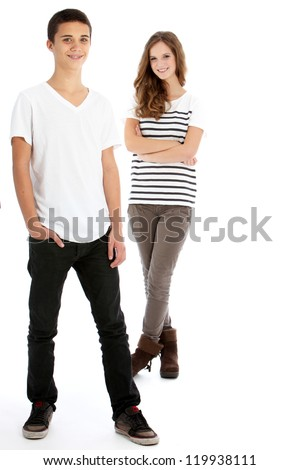 Full body studio portrait of two young trendy teenagers in smart casual clothes with the boy in the foreground and girl behind isolated on white
