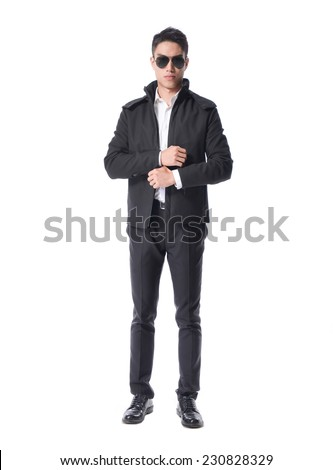 Full body Stylish bodyguard with glasses and folded arms. Isolated over white background - stock photo