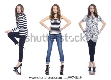 Full body three young woman in casual clothes posing in studio - stock photo