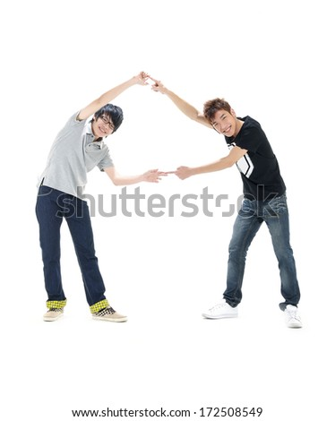 Full body two friends smiling to the camera having fun - stock photo