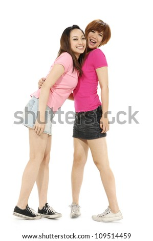 Full body two happy girls friends. Isolated over white background. - stock photo