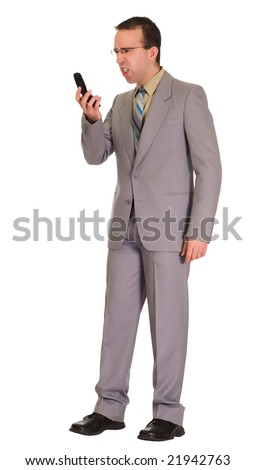 Full body view of a businessman getting mad at his cell phone - stock photo