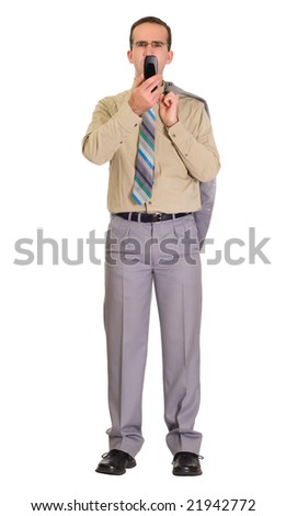 Full body view of a businessman sending a text message - stock photo