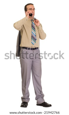 Full body view of a man talking on his cell phone - stock photo