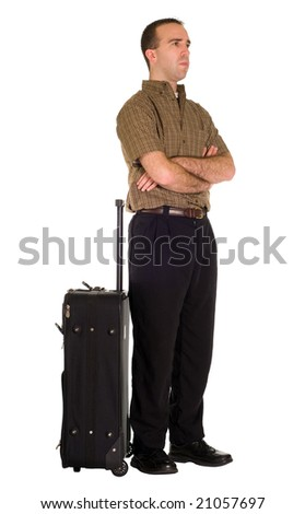 Full body view of a man waiting by his luggage, isolated against a white background - stock photo