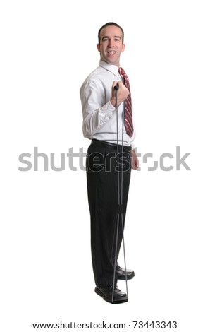 Full body view of a man wearing a tie, using a resistance band, isolated against a white background. - stock photo