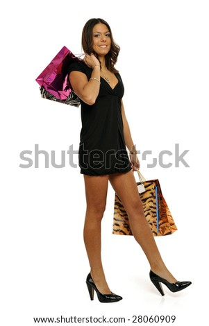 Full body view of young attractive woman going shopping with lots of colorful shopping bags. Isolated on white background. - stock photo
