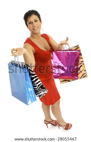Full body view of young attractive woman in red dress, going shopping with lots of colorful shopping bags. Isolated on white background.