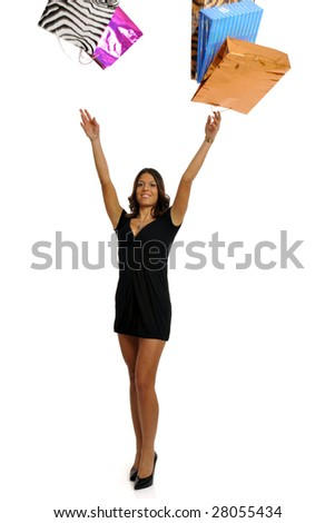 Full body view of young attractive woman throwing around lots of colorful shopping bags. Isolated on white background. - stock photo
